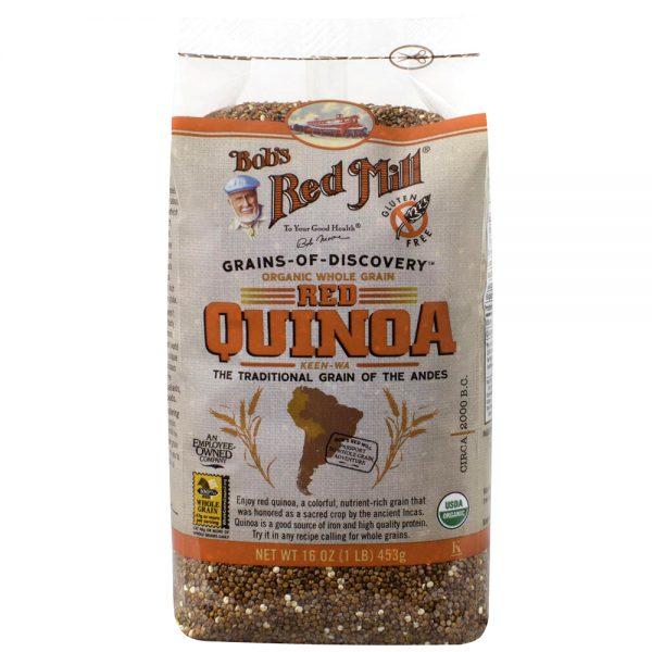 Органические, цельные зерна красной киноа (лебеды)